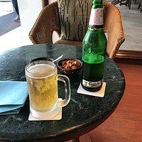 Elephant strength beer accompanied by snacks