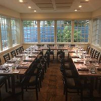 Glass Room set for a group dinner
