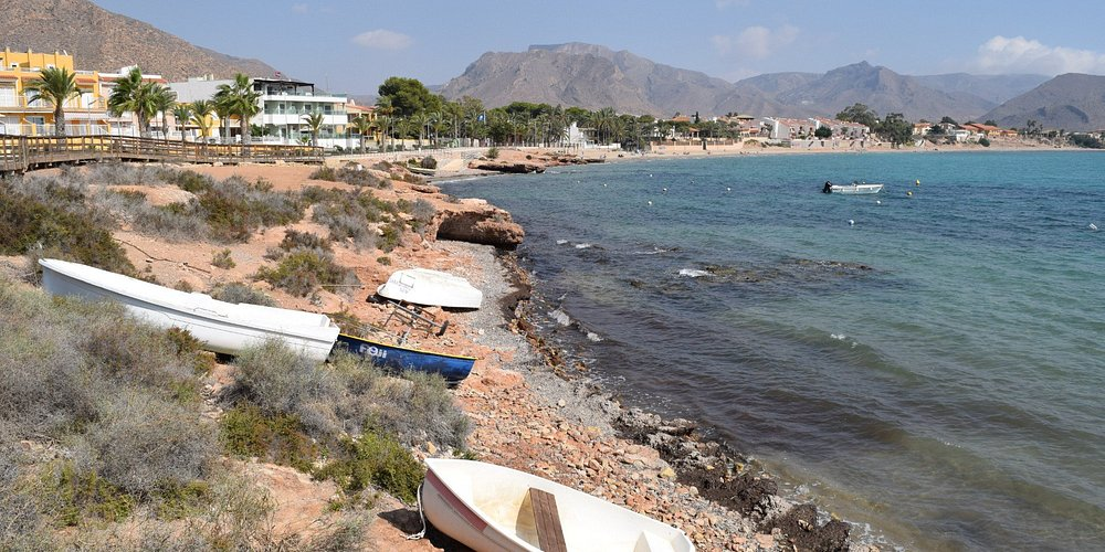 The view of the beach next to the Banos de la Marrana from the wooden walkway
