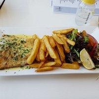 LOCAL GRILLED SALTWATER BARRAMUNDI, lemon butter sauce, salad, chips ($33)
