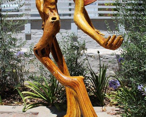 Remarkable driftwood sculpture of a Xhosa woman by Frans Boekkooi