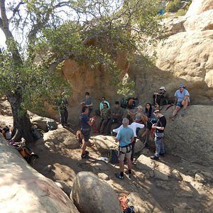 Owner and teacher of Uber Adventures explaining knots and anchors in Level 1 Canyoneering class.