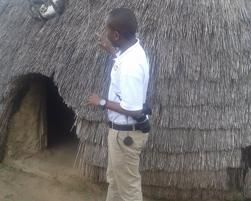 Theo explaining ancestors hut and reason for putting cow skulls in the entrance.