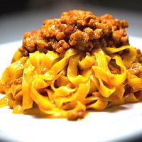 Handmade gluten-free tagliatelle with bolognese ragù sauce