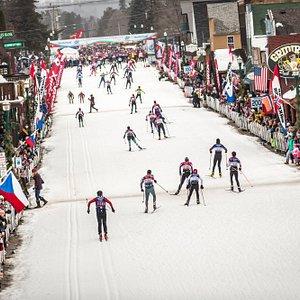 Skier's reaching the finish line crossing the Birkie Bridge