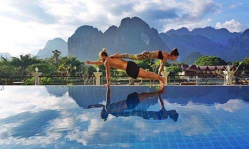 Yoga by the pool at Silver Naga Hotel, Vang Vieng