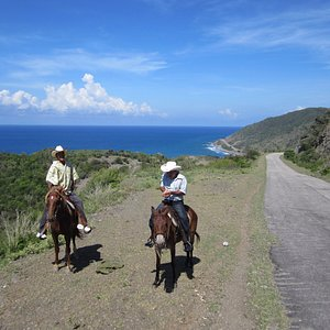 Cuba Horseback riding, coast highway towards Santiago.