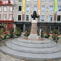 King Louis XIV Statue surrounded by flowers