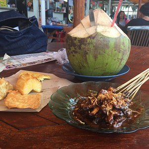 Satay chicken, coconut water, and fritters.