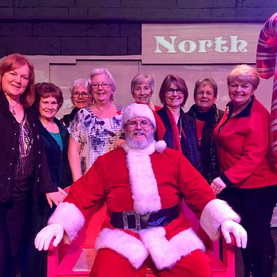 "My friends and I with Santa after ""Miracle on 34th Street"""