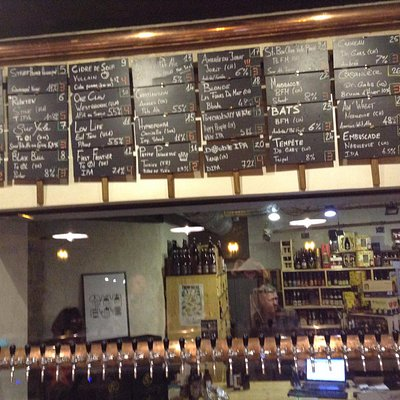 The current 32 beers on tap as listed above the window into the take-away beer shop.