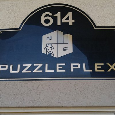 Puzzle Plex sign above door.