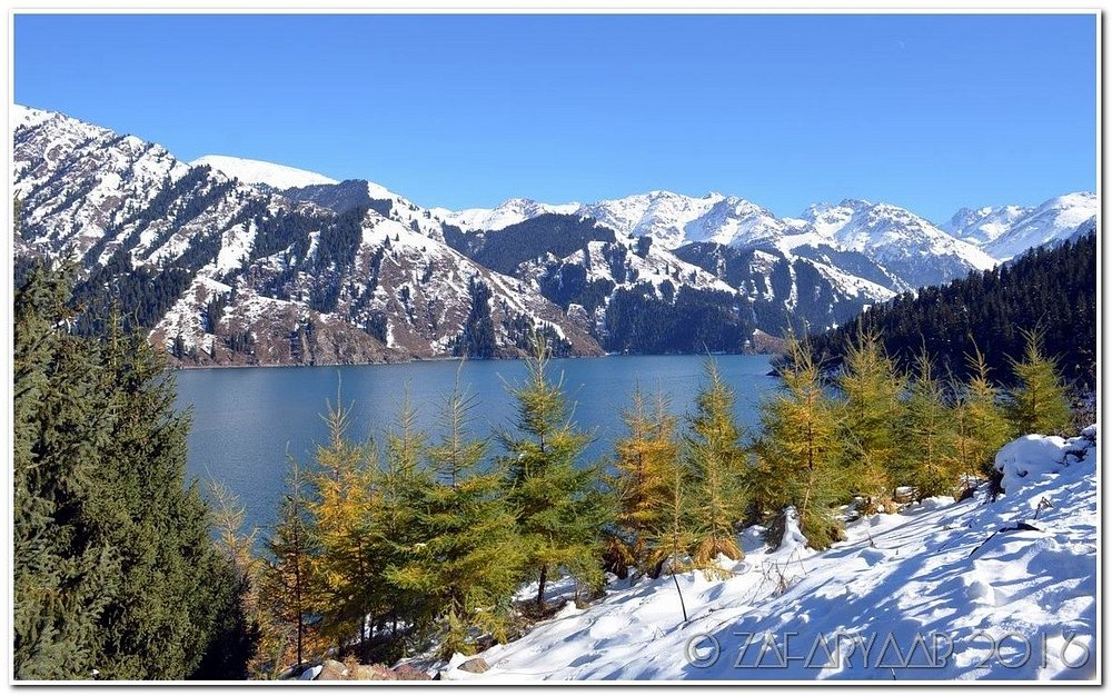 Alpine lake and snowcovered mountain of Tianshan