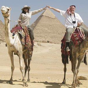 Kim and Jordon on a camel ride at Giza Pyramids. June 2006