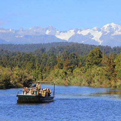 cruising up the Okarito river waterways - Mt. Cook and Tasman