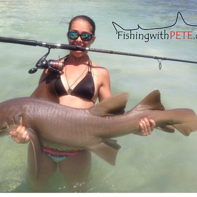 Erica standing in water with her Nurse Shark