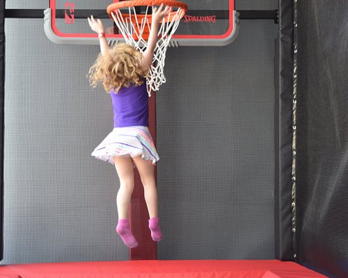 Kids can practice shooting baskets on a trampoline