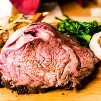 Golden Lamb Hickory-Roasted Prime Rib with potatoes, roasted garlic and broccoli rabe
