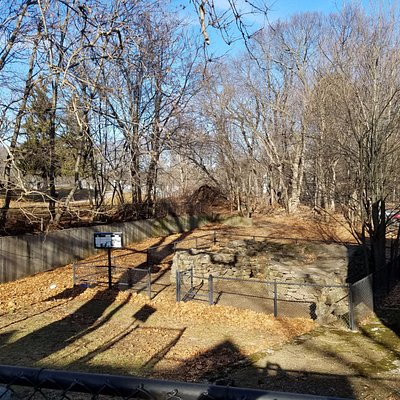 The foundation of the blast furnace below street level and just to the left of Furnace Brook