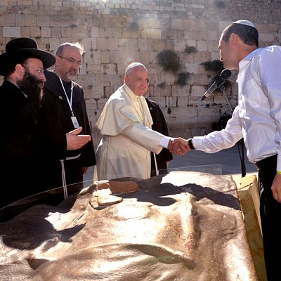 While guiding Pope Francis during his visit to the Western Wall in May 2014