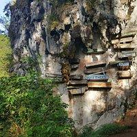 coffins hanging on vertical limestone cliffs