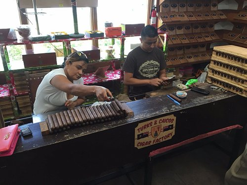 Cigars being rolled.