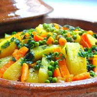Moroccan Tagine of Beef and  vegetables: Carrotes, Potatoes, and Greeen Peas.