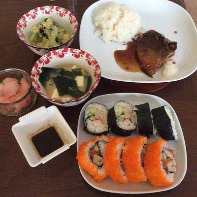 Japanese course with maki, California roll, salmon teriyaki, and tofu miso soup.