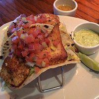 Three Fish Tacos with Avocado sauce.