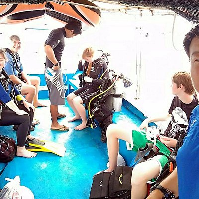Sunny pauses to take a photo of our family gearing up on the boat ride to Sapi Island (TARP).