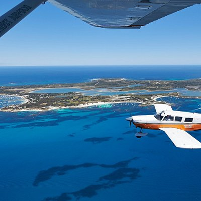 Rottnest Air-Taxi 6 Passenger Aircraft in front of Island