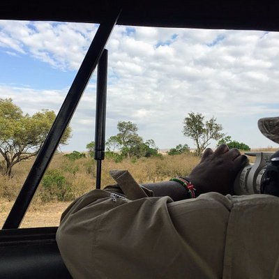 Our guide Eliud photographing a leopardess on our last day