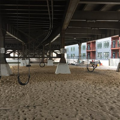 Swings from tires hang under the Holton Street bridge