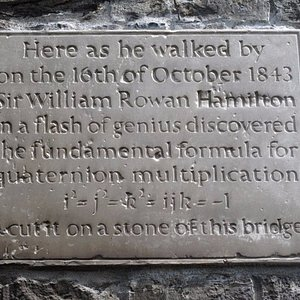 The plaque upon the bridge, opposite side to the station