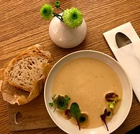 Onion soup with roasted shallots and thyme oil, served with freshly baked bread