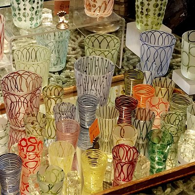 Collection of artisan glasses is interesting shapes and sizes