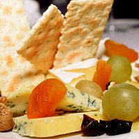 Selection of cheese and fruits