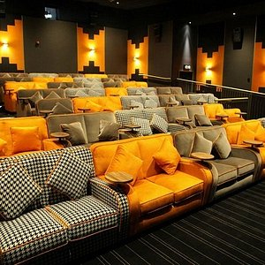 Come and try out our comfy sofas! Plenty of leg room and space for a glass of wine (or two!)