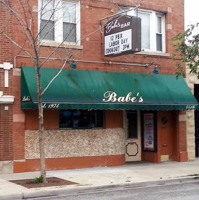 front of & entrance to Babe's