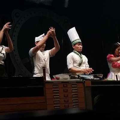 """Participants encouraging the audiance to join them in cheering on the """"cooking competition"""""""