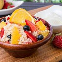 Quinoa alla frutta with strawberries, blueberries, papaya, orange and yogurt dressing.