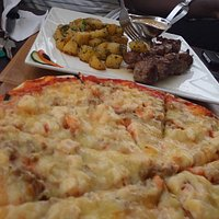 Delicous seafood pizza, tastes much better than it looks and tender lamb + aromatic herbed spuds
