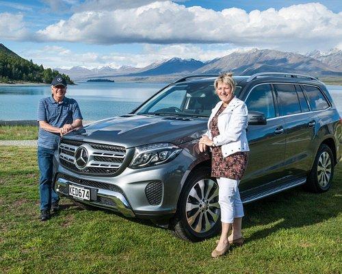 David & Cathy with their luxury Mercedes Benz 350 GLS at Lake Tekapo