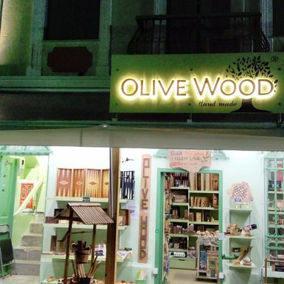 The OLIVE WOOD store in a summer night..