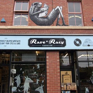 Shop front by David wilkinson, figure reading by Phlegm