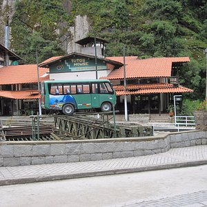 Miniature Bus outside the bus pick-up/ drop-off zone.