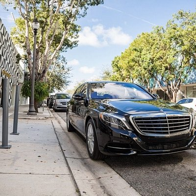 Classy modern  limousine and airport transportation .
