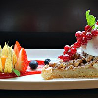 Cashew nut cake with ice-cream and berries