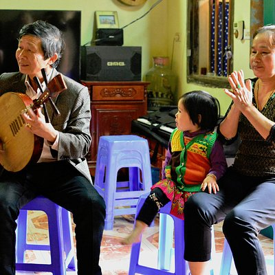 Mr. Viet entertaining with music and song