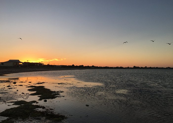 Sunset at Indented Head Beach, view across Half Moon Bay